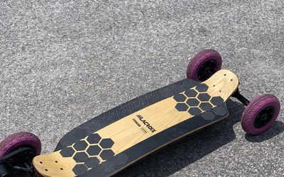 Lacroix electric skateboard rental in Cameron