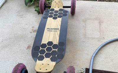 Lacroix electric skateboard rental in Cameron