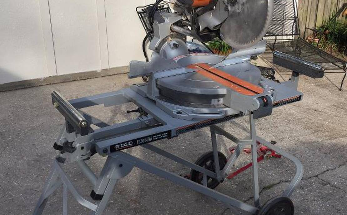 "Ridgid 12"" Sliding compound miter saw on rolling stand."