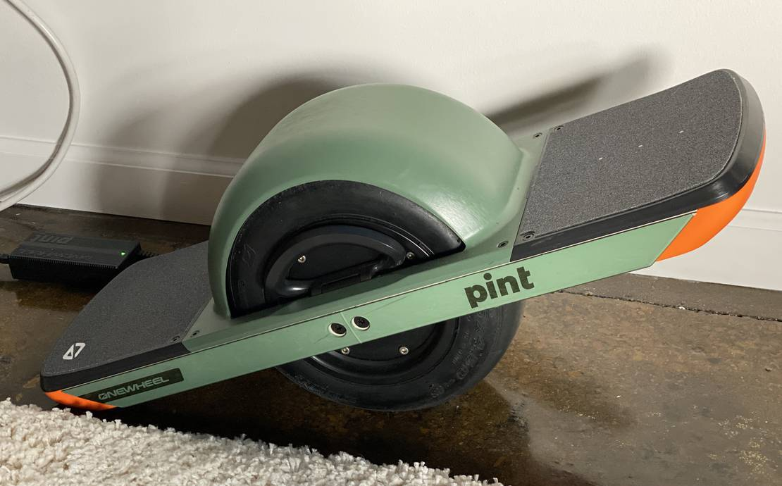 OneWheel pint, Triple 8 Adult size L helmet and Triple 8 size L wrist guards included.